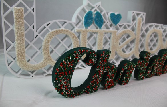 Lasercut letters and bead detailing for