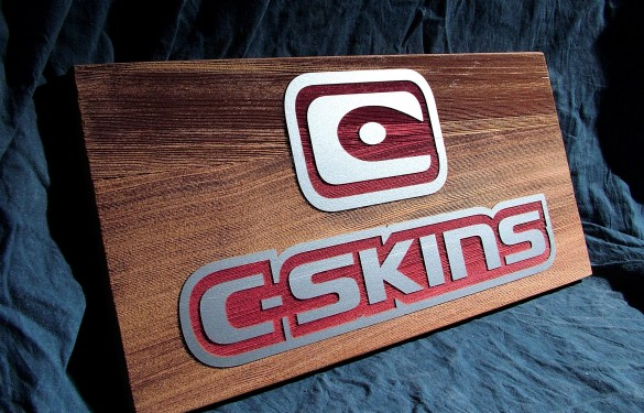 sandblasted-c-skins-wetsuits-point-of-sale-in-wood - the grain - wooden sign