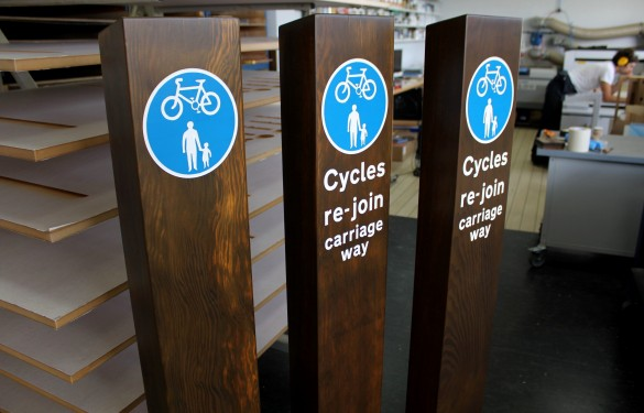 pressure treated cycle route wayfinding signs for
