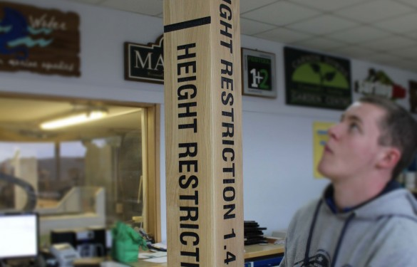 Laser engraved height restriction barriers