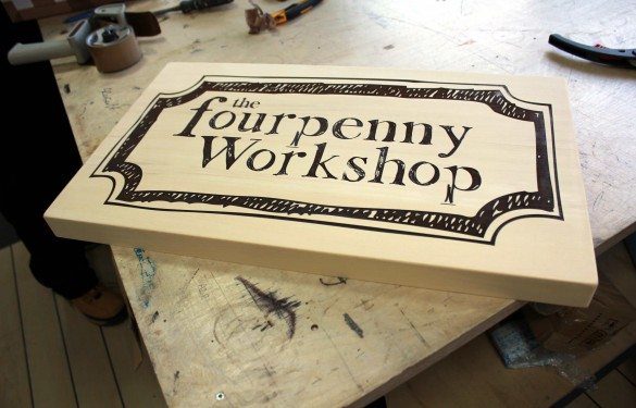 laser carved and color filled sign for